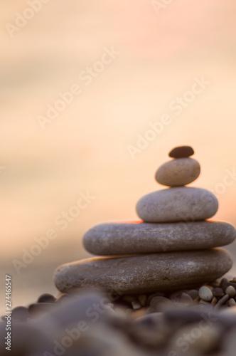 Fotomural  stack of zen stones on pebble beach