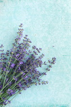 Flowers Background. Frame Pattern Of Lavender Flowers On Pale Blue Vintage Background. Top View. Copy Space