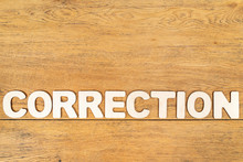 Word Correction On A Wooden Board