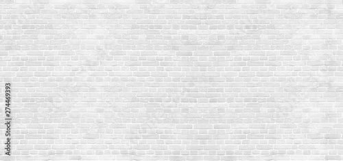 Poster Graffiti Panoramic background of wide old white brick wall texture. Home or office design backdrop