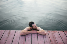 Man Relaxing And Swimming In T...