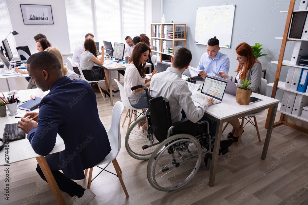 Fototapety, obrazy: Disabled Businessman Sitting On Wheelchair Using Laptop