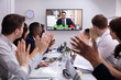 canvas print picture - Businesspeople Having Video Conference In Boardroom