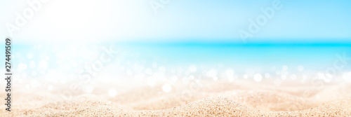 Fotografie, Obraz Tropical Beach Background With Soft Sunlight, Sand, Sparkling Blue Water And Cle