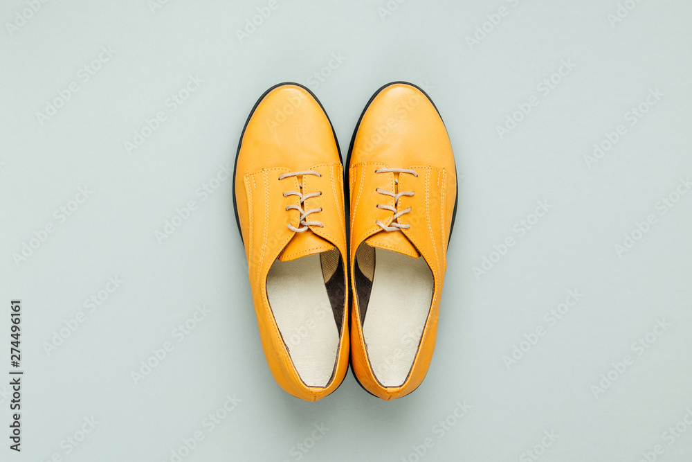 Fototapeta Stylish female spring or autumn shoes in various colors. Beauty and fashion concept. Flat lay, top view