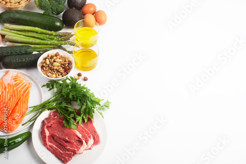 Fototapeta Ketogenic, keto diet, including vegetables, meat and fish, nuts and oil on white background with copy space obraz