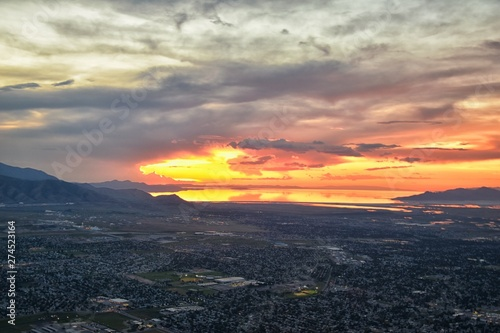 Great Salt Lake Sunset Aerial view from airplane in Wasatch Rocky Mountain Range, sweeping cloudscape and landscape during day time in Spring. In Utah, United States.