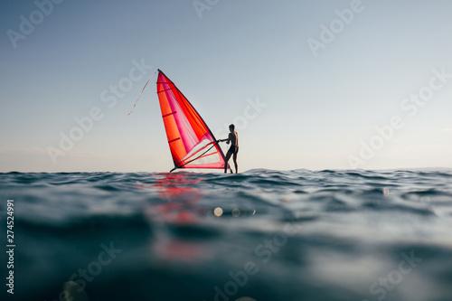 Surfer uplift windsurf board  Low angle view of windsurfer