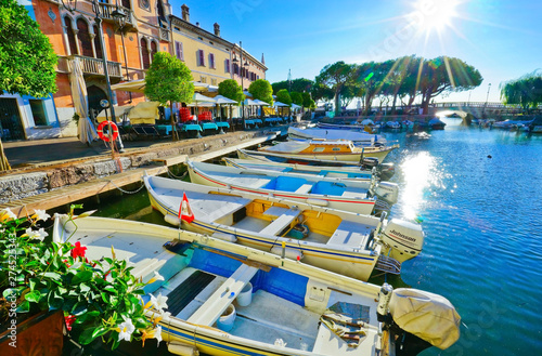 Staande foto Mediterraans Europa View of Desenzano del Garda at the lakeside of Lake Garda in summer.