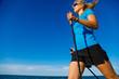 Leinwandbild Motiv Nordic walking - young woman training