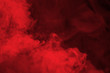 canvas print picture Abstract red  smoke on black background. Dramatic red smoke clouds. Movement of colorful smoke.