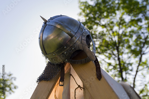 Fototapeta Metal helmet of ancient war close-up. Historical reconstruction