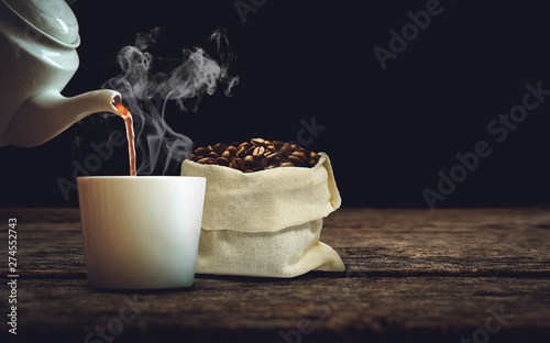 Door stickers Cafe Pour the coffee into the cup with coffee beans in sack on old wooden board. vintage and dark tone