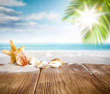 Desk Of Free Space For Your Decoration And Summer Background Of Beach.