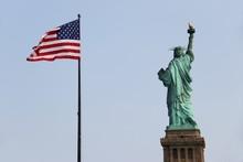 Statue Of Liberty With US Flag - New York – USA