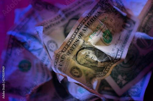 close up wrinkled American one dollar bills pile under