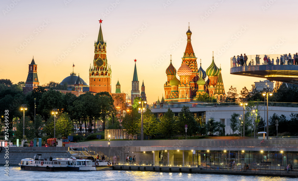 Fototapety, obrazy: Moscow Kremlin and St Basil`s Cathedral at sunset, Russia. Zaryadye Park on embankment of Moskva River. Evening view of the Moscow landmarks. Beautiful panorama of the Moscow city center at night.