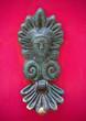Leinwanddruck Bild - An old style decorative bronze door handle on a wooden red door, the distinctive feature and symbol of Malta in Mdina.