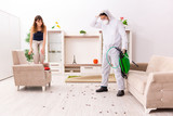 Young professional contractor doing pest control at flat  - 274576563