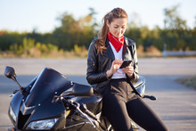 Young Female Biker With Phone ...