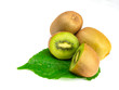 Green kiwi fruit and halves on leaves, isolated on a white background.