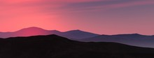 Silhouettes Of Hills At Sunset, Mountain Slopes Against The Setting Sun