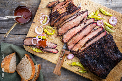 Traditional smoked barbecue wagyu beef brisket offered with farmhouse bread as t Wallpaper Mural