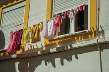 Clothes Hanging On Window Drying In A Colorful House