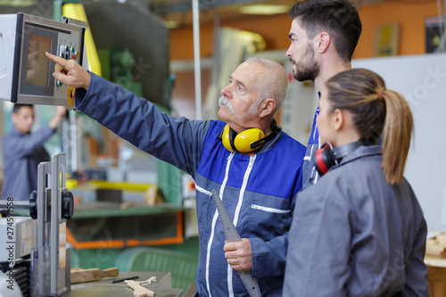 young apprentices in industry sector Wallpaper Mural