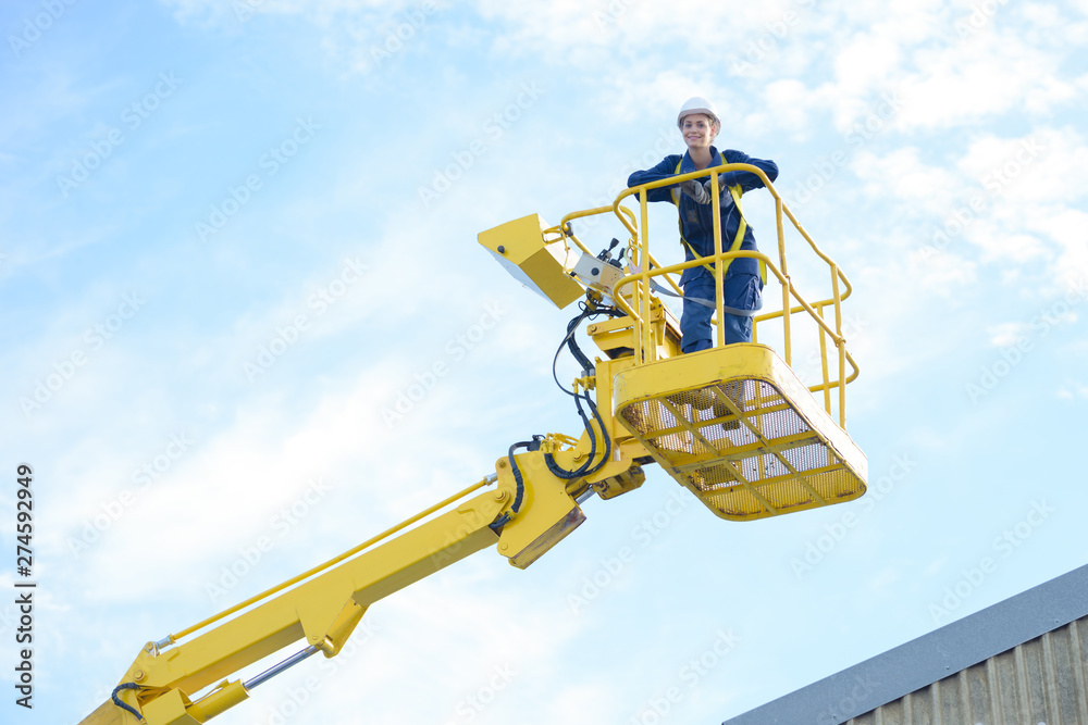 Fototapety, obrazy: woman worker on top of a platform