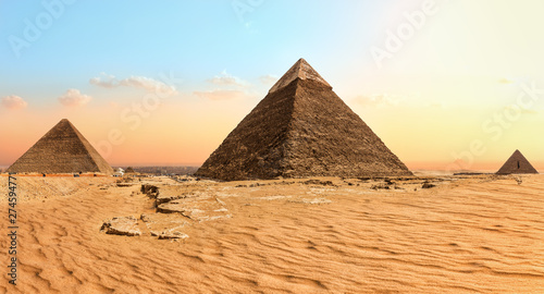 Photo Stands Egypt Famous Giza Pyramids in the sand desert, Egypt
