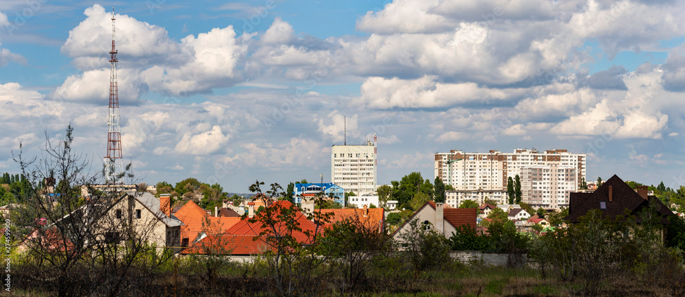 Fototapety, obrazy: Outskirts of Chisinau. Panorama with the capital of Moldova. Cloudy sky before the rain.