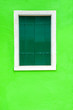Leinwanddruck Bild - Window with green shutters on the green wall. Colorful architecture in Burano island, Venice, Italy.