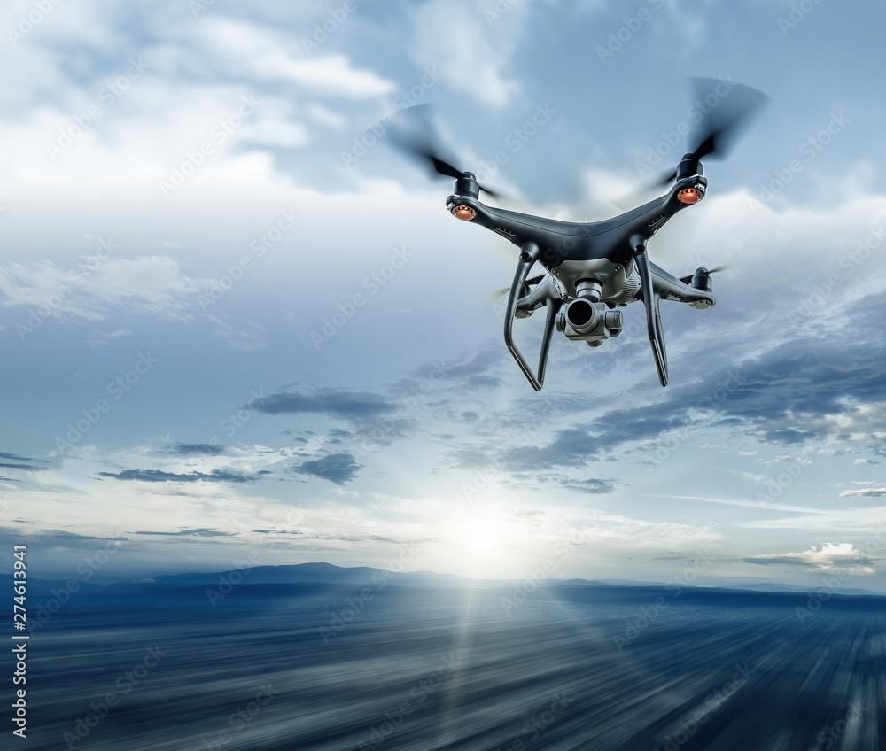 Fototapety, obrazy: Dark drone in flight over the city.