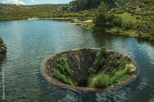 Photo Large sinkhole in a dam lake on the highlands