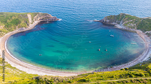 Cuadros en Lienzo A view of the Lulworth Cove along the Jurrassic Coast in Dorset under a majestic blue sky and some white clouds
