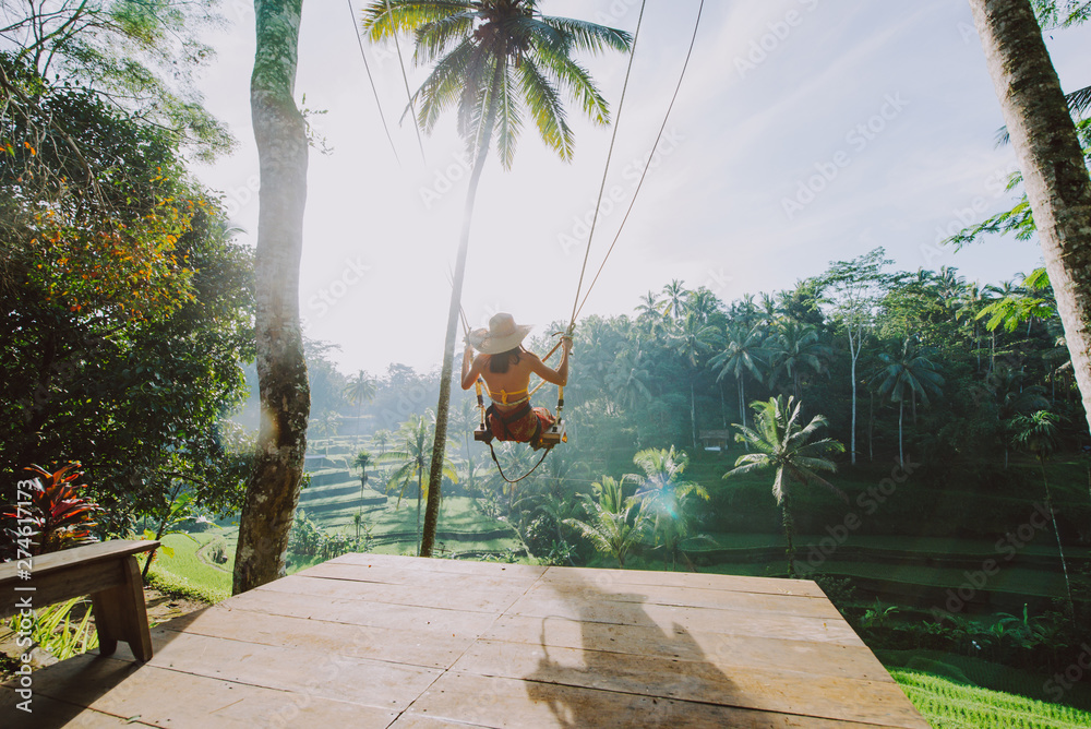 Fototapety, obrazy: Beautiful girl visiting the Bali rice fields in tegalalang, ubud. Using a swing over the jungle. Concept about people, wanderlust traveling and tourism lifestyle