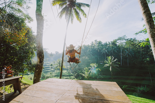 Foto op Canvas Bali Beautiful girl visiting the Bali rice fields in tegalalang, ubud. Using a swing over the jungle. Concept about people, wanderlust traveling and tourism lifestyle