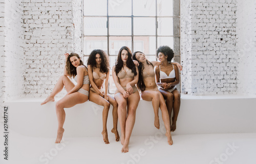 Fotografie, Tablou Group of women with different body and ethnicity posing together to show the woman power and strength