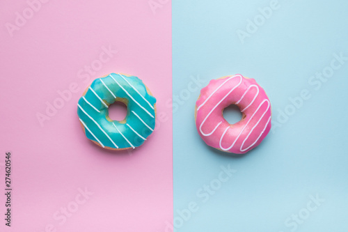 Blue and pink donuts on pink and blue background. Wallpaper Mural