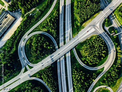 Aerial view of highway and overpass with green woods in Finland. Canvas Print
