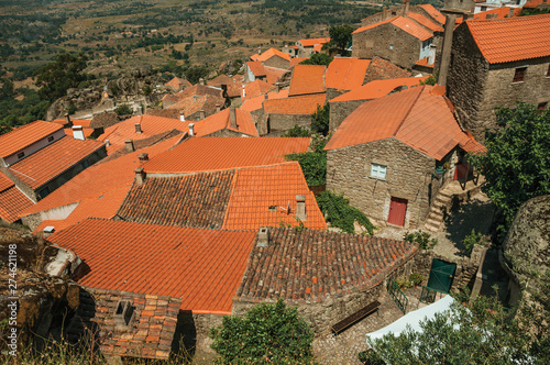 Old stone houses with church steeple at Monsanto Fototapet