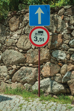 Alley With Stone Wall And WEIGHT LIMIT AHEAD Traffic Sign