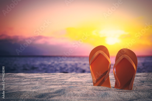 Poster de jardin Plage Stylish flip flops on beach