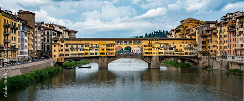 The Ponte Vecchio, or Old Bridge, is a medieval stone arched bridge over the Arno river in Florence, Italy Canvas Print