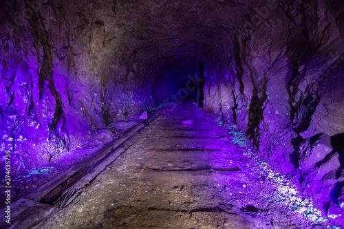 Obraz na plátně  Abandoned uranium mine illuminated by ultraviolet light