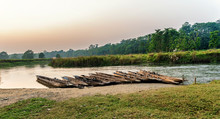 Boats Made, Carved From One Piece Of Wood At The Bank Of The River In Chitwan National Park, Nepal.