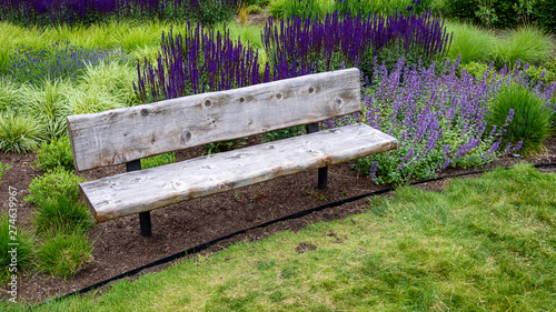 Amazing Rustic Wood Garden Bench Surrounded By Ornamental Grasses Ncnpc Chair Design For Home Ncnpcorg