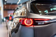 modern car led tail lights in showroom