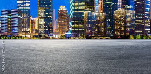 Shanghai modern commercial buildings and empty asphalt road at night Canvas Print